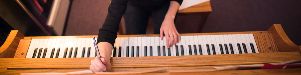piano keyboard with hands playing