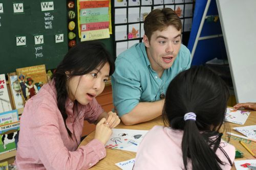 Chinese students teaching elem students