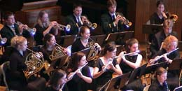 shot of concert band playing their instruments in concert