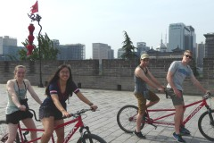 Riding bicycles built for two in China