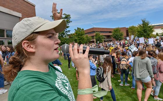 Jillian Scannell speaks in microphone to crowd