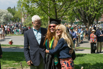 Parents hugging UVM graduate