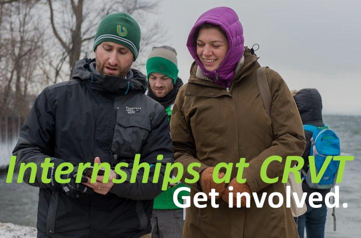 Internships at CRVT: get involved. Two interns consult equipment by Lake Champlain