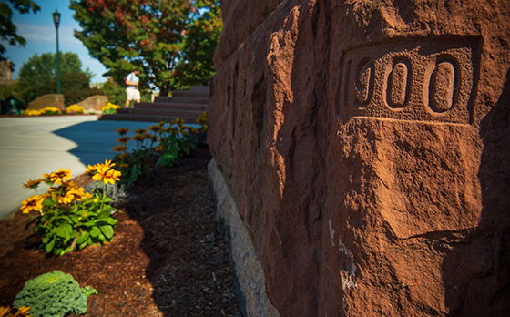 Close up of a brick on Billings Library. The date 1900 is carved into it.
