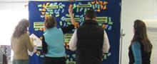 People creating presentation board
