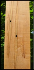 a maple board with sample holes in it