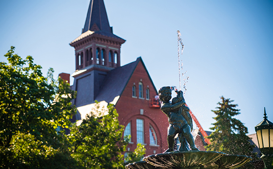 Water sprays from a fountain in front of the Old Mill building at University of Vermont