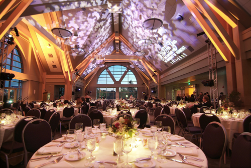 Wedding reception ballroom set up with vaulted ceilings