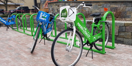 Green Bikes parked on campus