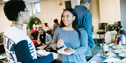 Students chat over a meal at the mosaic center for students of color