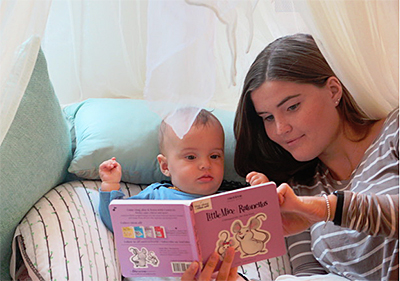 Caregiver reading to baby