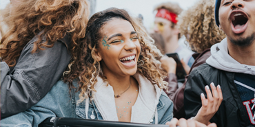 Student laughing in the SpringFest crowd