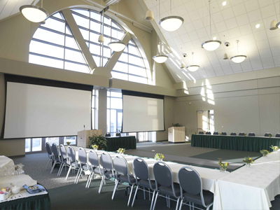 UVM Livak Ballroom Conference Tables Set-up with Two Projector Screens