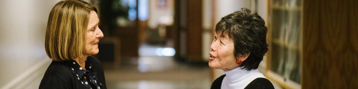 Helga Schreckenberger and Rae Nishi converse