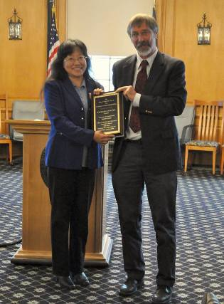 Dr. Liang receives the Hubert Vogelmann award from the Dean of the College of Agriculture and Life Sciences, Thomas Vogelmann.