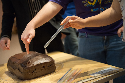 Taking core samples from a cake.