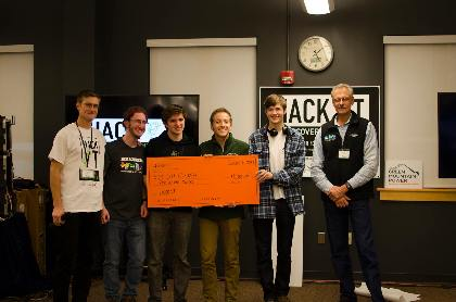 students receiving check for $500