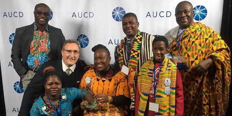 Sefakor with AUCD Director, family, and friends at the AUCD Award Ceremony