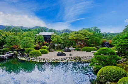 Garden with pond, pagoda, stone bridge at Adachi Museum of Art in Yasugi, Japan