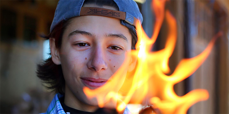 Adam Liszewsk lights fire with his natural fire starter product.