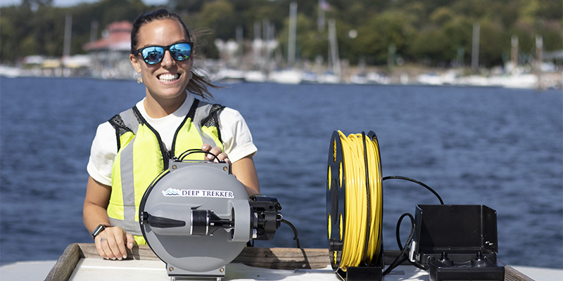 Ashley runs equipment on a research boat on Lake Champlain