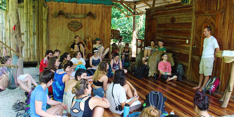 Students in Costa Rica outdoor classroom listen to a community partner speak