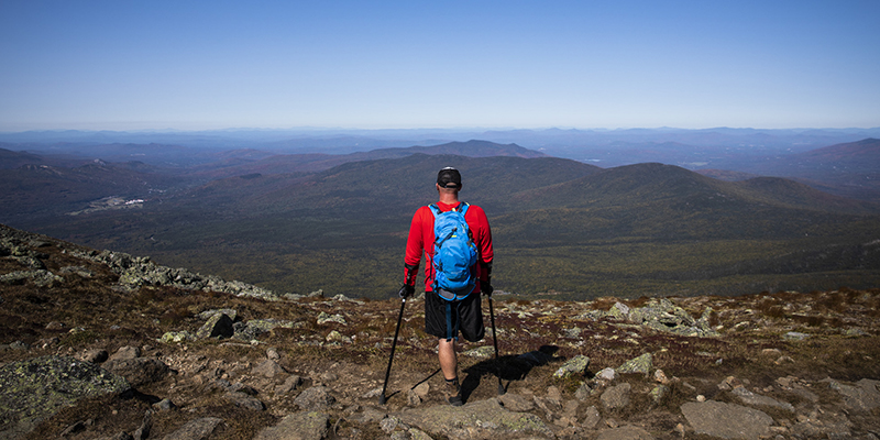 Dana Albrycht takes in the views on a hike in the White Mountains, New Hampshire.