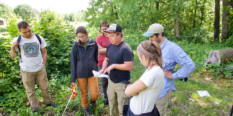 Rubenstein School Ph.D. student David Gudex-Cross works with student assistants in the field.