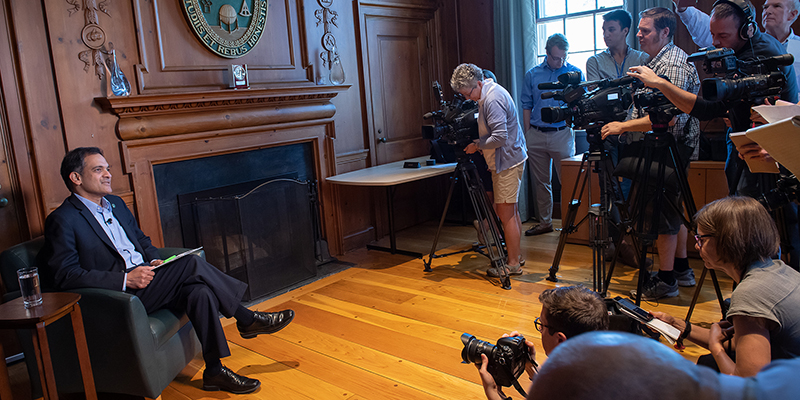 President Garimella speaks with members of the media in his office