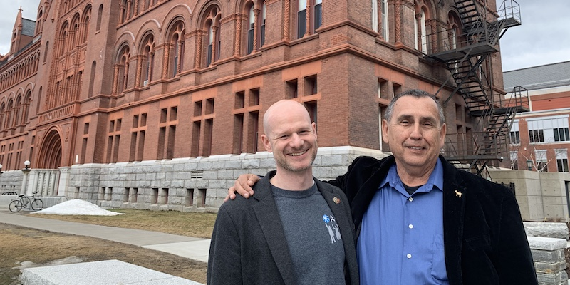Jesse Suter and Jesús Treviño in front of UVM building