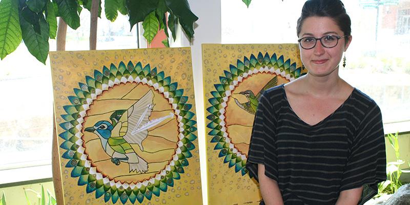 Jessica Mailhot displays her artwork.