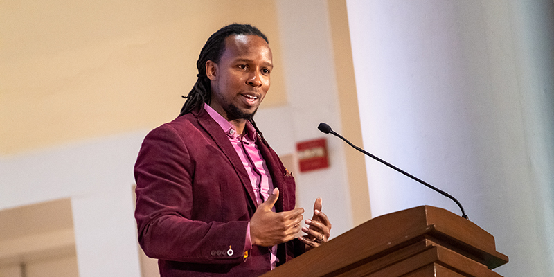 Ibram X. Kendi speaks at a lecturn at the University of Vermont