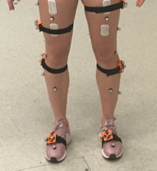 close-up of wearable sensors on legs