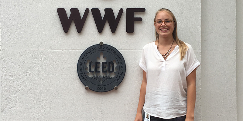 Leah Cawthorne stands next to World Wildlife Fund sign