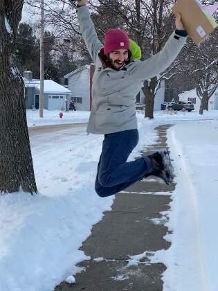 man jumping on sidewalk