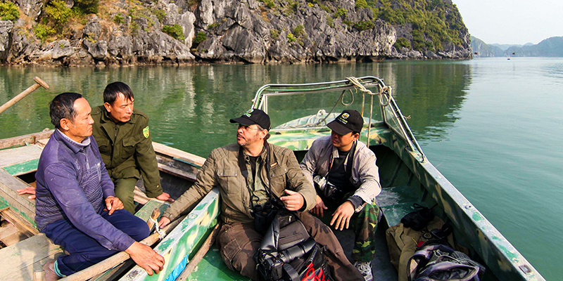 Alum Neahga Leonard in boat with Vietnamese colleagues