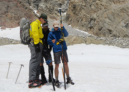 Oliver Scofield works with ranger on glacier at Grand Teton National Park.