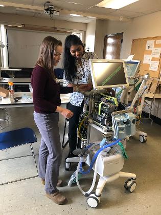 Two students repair ventilator