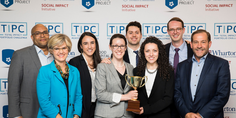 UVM's SI-MBA team shows off their trophy with competition judges