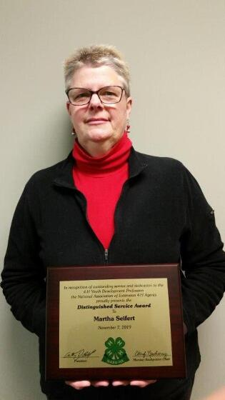 Martha Seifert holds the 2019 Distinguished Service Award