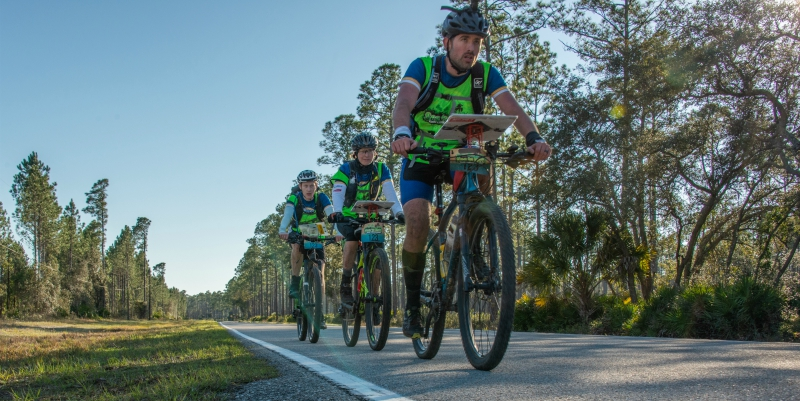 Adventure racers bicycling