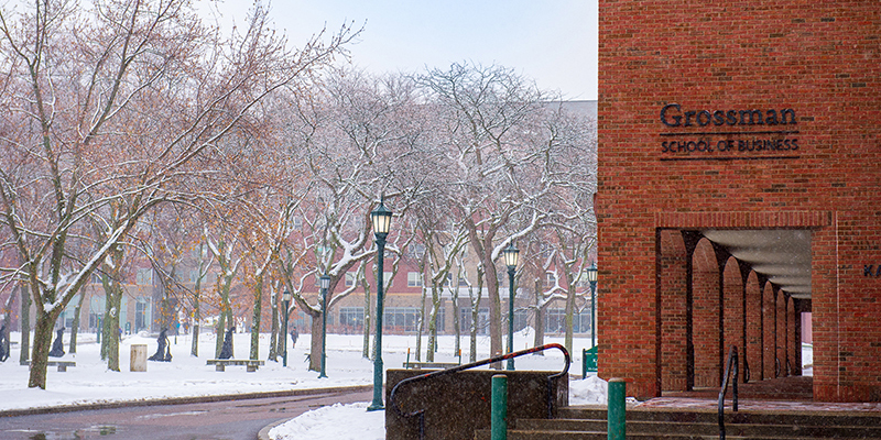 The Grossman School of Business sits on a snow-covered campus at the University of Vermont.