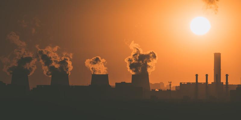 Image of smoke stacks emitting emissions.