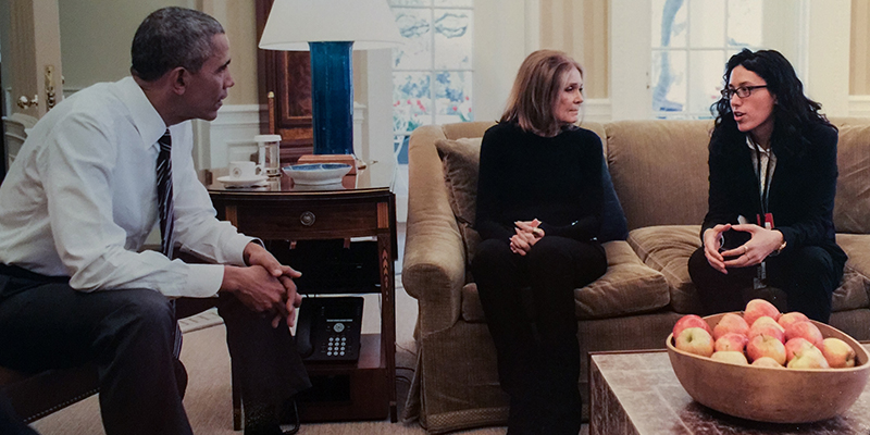 President Barack Obama, Gloria Steinem and Ariel Wengroff sit in the Oval Office, talking.