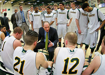 John Becker talking to his team on the court