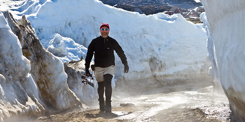 UVM geologist Paul Bierman on melting ground in Greenland.