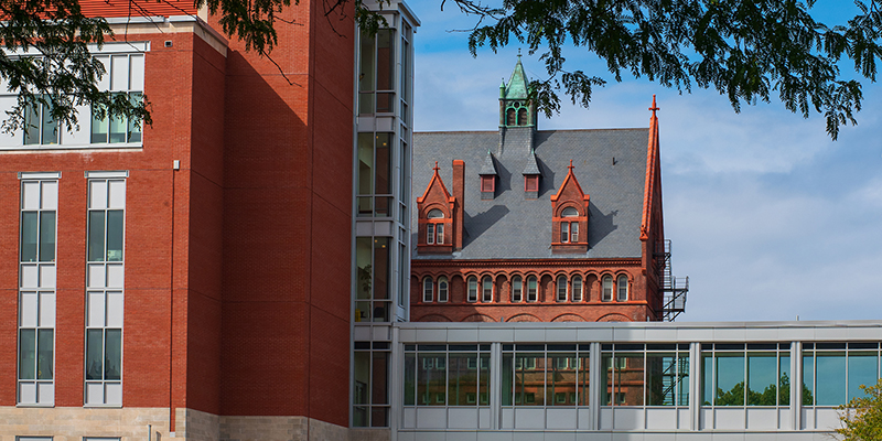 UVM's Discovery Hall building and a skybridge stand in front of Williams Hall