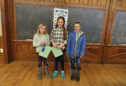 Three novice 4-H students who competed in the quiz bowl.