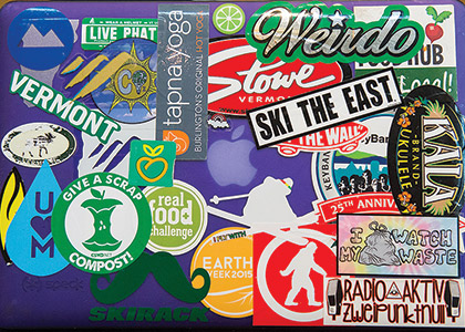 Stickers on computer for ski resorts, composting, UVM programs