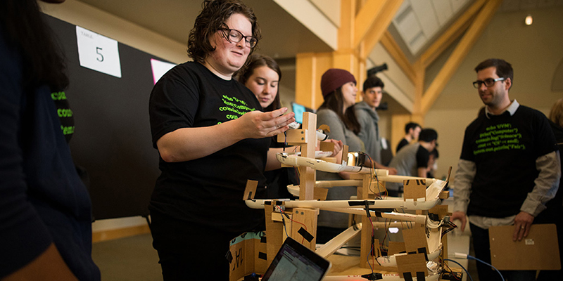 Students demonstrate their project at the Computer Science Fair.